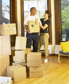 Image of couple moving boxes