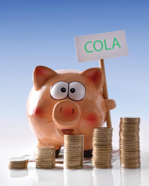 Piggy Bank holding COLA sign